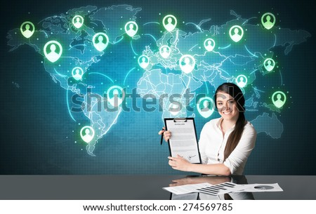 Businesswoman sitting at table with social media connection symbols on the world map