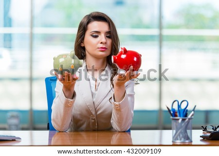 Businesswoman sitting at the office desk - stock photo