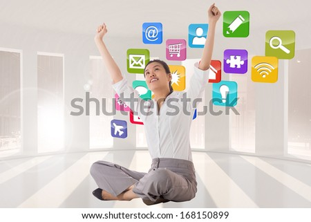 Businesswoman sitting cross legged cheering against abstract cloud design - stock photo