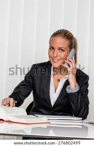 businesswoman sitting in an office. symbol photo for managers, self or lawyer. - stock photo