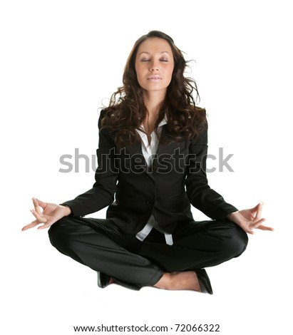 Businesswoman sitting in lotus flower position - stock photo