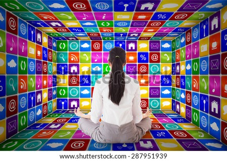 Businesswoman sitting in lotus pose against app room - stock photo