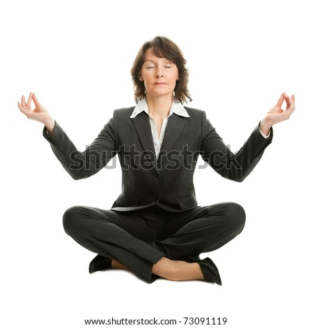 Businesswoman sitting in lotus position - stock photo