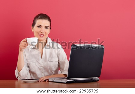 Businesswoman sitting in the office drinking a coffee