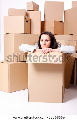 businesswoman sitting inside the box , carton box background