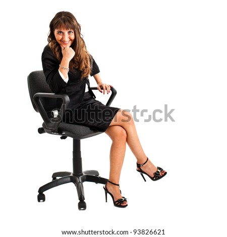 Businesswoman sitting on a chair isolated on white - stock photo