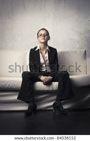 Businesswoman sitting on a sofa - stock photo