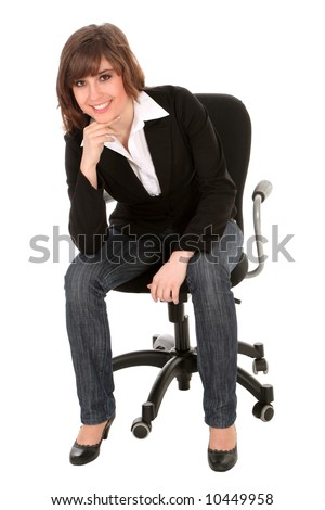 Businesswoman sitting on an office chair - stock photo