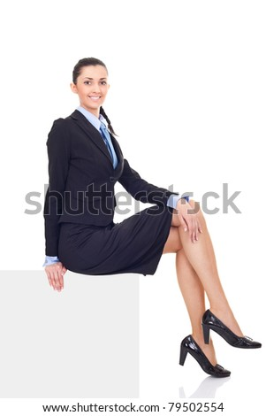 businesswoman sitting on  big blank billboard, woman dressed in suit,  isolated on white background - stock photo
