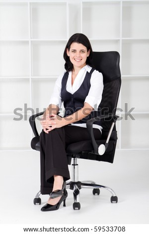 businesswoman sitting on office chair - stock photo