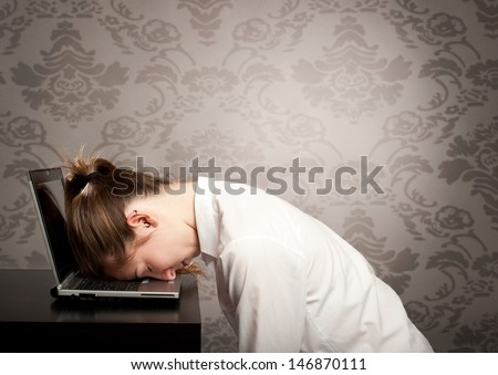 businesswoman sleeping on laptop - stock photo