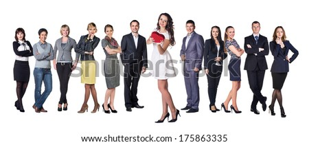 Businesswoman smile present gift red heart shaped box in hand. Woman over big group of Business people on background
