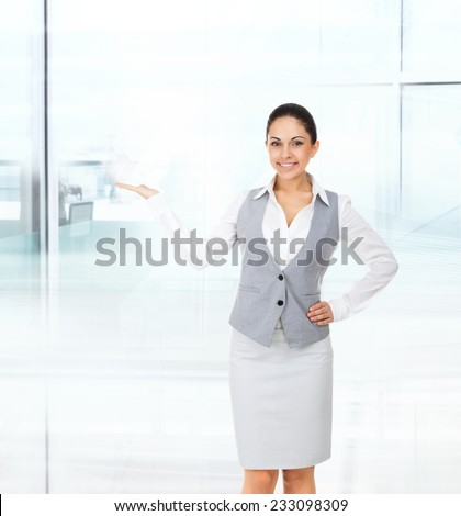 Businesswoman smile show open palm empty copy space, business woman showing pointing side, concept of advertisement product in modern office - stock photo