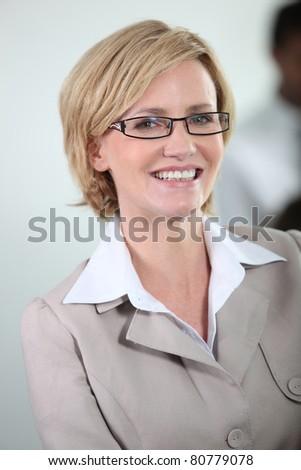 Businesswoman smiling. - stock photo