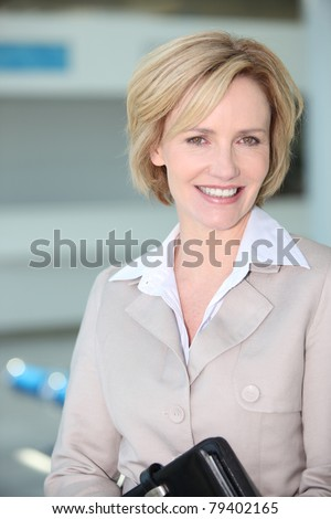 Businesswoman smiling at airport