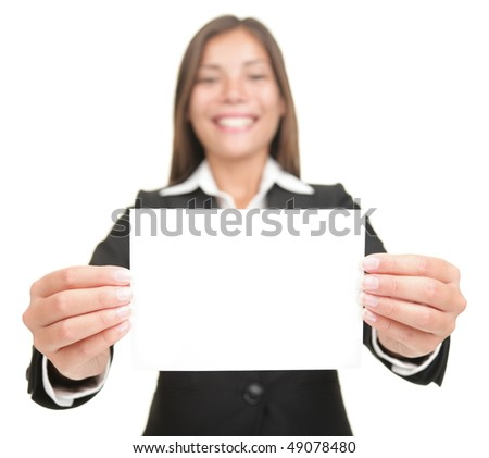 Businesswoman smiling holding empty blank sign. Excited version also available,  Beautiful mixed chinese asian / caucasian business woman. Isolated on seamless white background. - stock photo