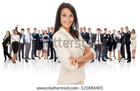 businesswoman smiling standing with folded hands over big group of businesspeople crowd background, business woman happy smile