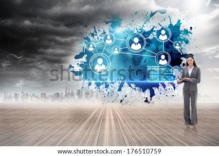 Businesswoman smiling with a laptop against splash showing international business - stock photo