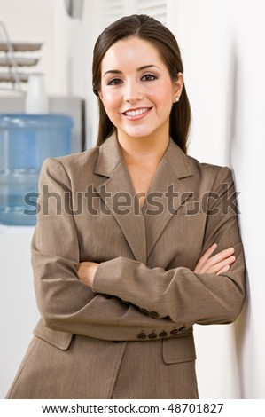 Businesswoman smiling with arms crossed - stock photo