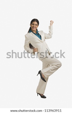 Businesswoman smiling with her hand raised - stock photo