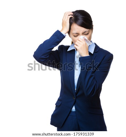 Businesswoman sneeze and headache - stock photo