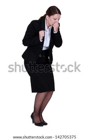 Businesswoman sneezing - stock photo