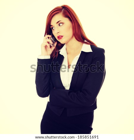 Businesswoman speaking on the phone. Isolated on the white background - stock photo