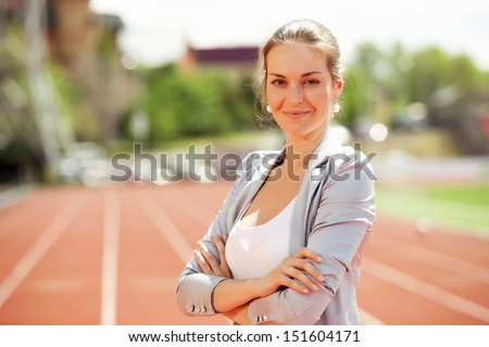 Businesswoman sport manager and executive at athletic stadium and race track - stock photo