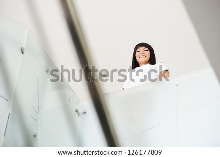 Businesswoman standing alone - stock photo