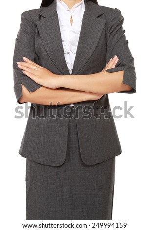 businesswoman standing and folded hands, isolated on white background - stock photo