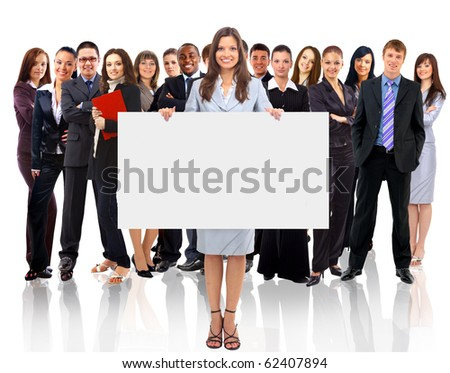 Businesswoman standing and holding a white empty billboard - stock photo