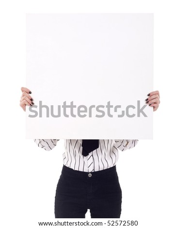 Businesswoman standing and holding a white empty billboard or signboard over her face - stock photo