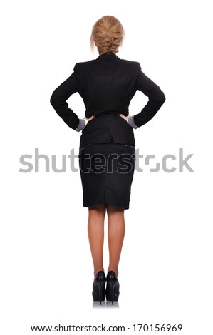 businesswoman standing back on a white background - stock photo