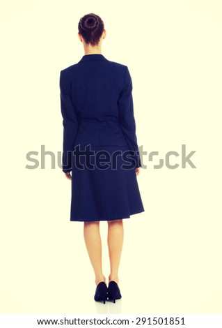 Businesswoman standing back to camera - stock photo