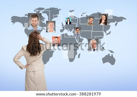 Businesswoman standing back to camera with hand on head against blue background - stock photo
