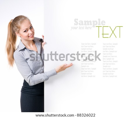 Businesswoman standing behind blank whits billboard. Isolated over white - stock photo