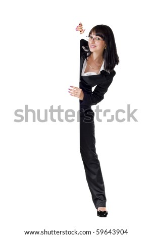 Businesswoman standing beside a billboard. Isolated - stock photo