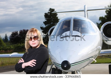 Businesswoman standing by corporate jet