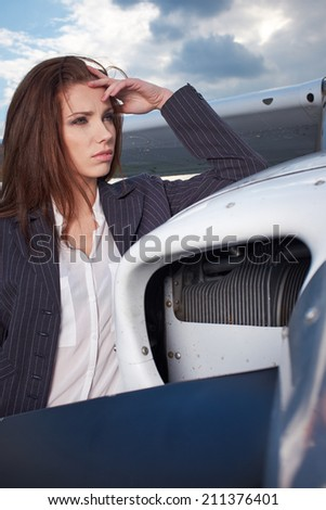 Businesswoman standing by his private plane