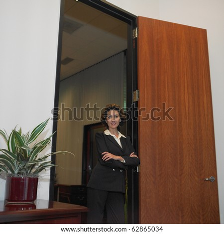 Businesswoman standing in doorway