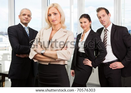 Businesswoman standing in front - stock photo