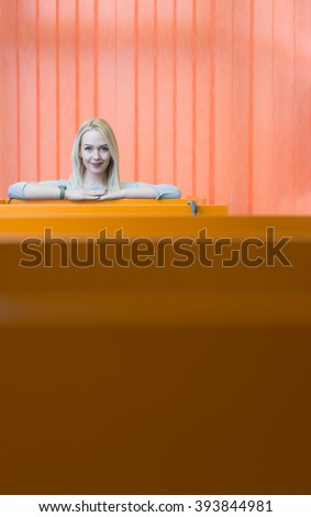Businesswoman standing in front of window in offfice