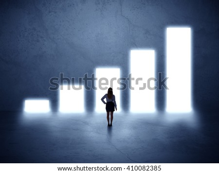 Businesswoman standing in the front of growth chart of profits - stock photo