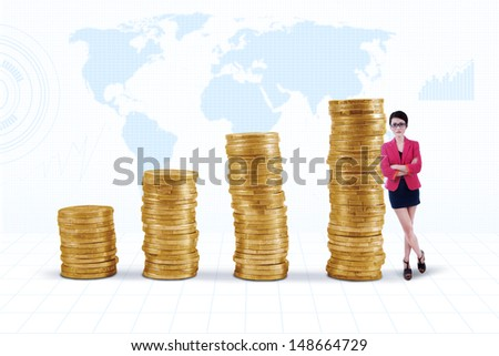 Businesswoman standing next to gold coins chart on white