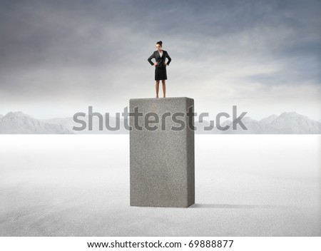 Businesswoman standing on a high cube