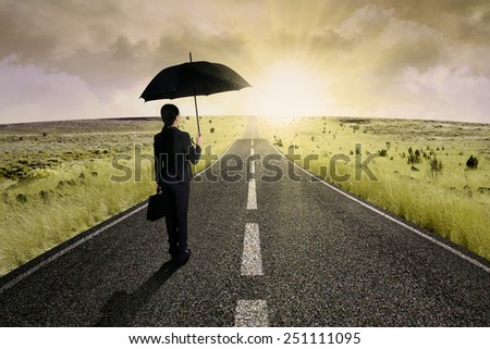 Businesswoman standing on the highway road, symbolizing as the way to the new opportunity - stock photo