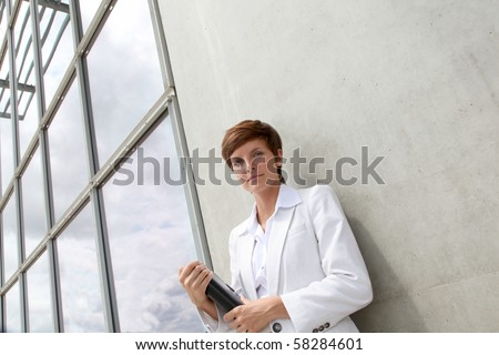 Businesswoman standing outside the office - stock photo
