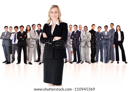 Businesswoman standing up with colleagues in background - stock photo