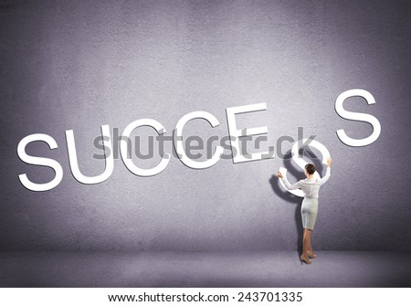 Businesswoman standing with back and making word success - stock photo