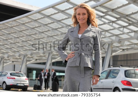 Businesswoman standing with hand on hip - stock photo